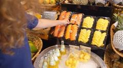 Woman Choosing Fresh Sliced Fruits at Organic Market Stock Footage