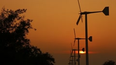 Wind turbine power generator at twilight in Bang Pu Recreational Retreat Center Stock Footage