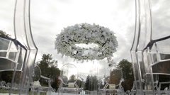 Wedding Arch And  wHITE Chairs In The Open Air Stock Footage