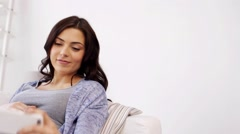 Pregnant woman taking selfy by smartphone at home Stock Footage