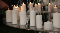 Many white candles  on the table - stock footage