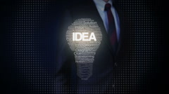 Businessman touching shape of bulb light, texts makes bulb, showing text 'IDEA' Stock Footage