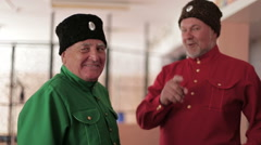 Two elderly men in Russian national costumes Stock Footage