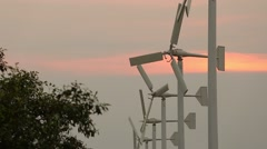 Wind turbine power generator at twilight in Bang Pu Recreational Retreat Center - stock footage