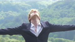 Happy Buninessman closed eyes spread arms on top of the world 4K ULTRA HD - stock footage