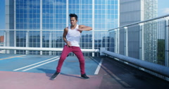 4K Young urban street dancer showing off some moves in urban environment.  Stock Footage