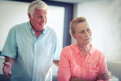 Senior woman ignoring a senior man while argument Stock Photos