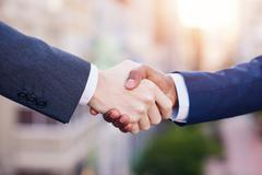 Shaking hands on a new business merger Stock Photos