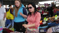 Antalya, Turkey - March 2016: Mom and daughter trying to choose oriental sweets - stock footage