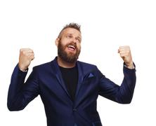 Lucky winner. Bearded man in suit happy of success Stock Photos