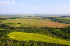 Flat open landscape with agricultural fields Stock Photos