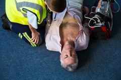 Paramedic using an external defibrillator during cardiopulmonary resuscitatio Kuvituskuvat