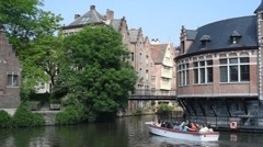 Tourist boat on the river Lys along the Oude Vismijn in Ghent, Belgium Stock Footage