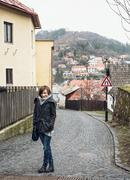 Young tourist woman posing in historical street in Banska Stiavnica, Slovak r Stock Photos