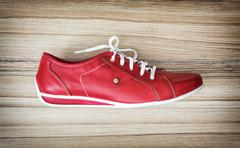 One new red women's leather shoe, beauty and fashion - stock photo