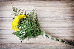 Bouquet of yellow gerbera daisies on the wooden background, birthday gift Stock Photos
