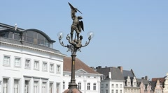 Lamppost with statue of Archangel Michael atSt Michael's bridge, Ghent, Belgium - stock footage