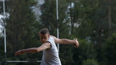 Athlete throwing discus - stock footage