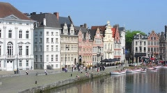 Tourists walking along the Korenlei, Ghent, Flanders, Belgium Stock Footage