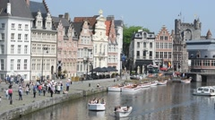 Tourists walking along the Korenlei, Ghent, Flanders, Belgium Stock Footage