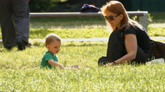 Mother and child playing in sand Stock Footage