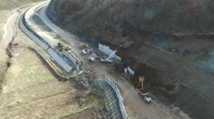 Aerial view on machines working on highway construction. Serbia. Stock Footage