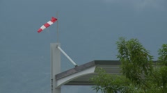 Windsock with cloudy sky - stock footage