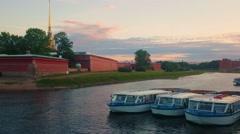 Boats on the river near Petropavlovskaya fortress in Saint-Petersburg, Russia Stock Footage