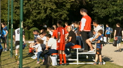 Group of football supporters watching football soccer Stock Footage