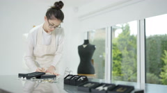 4K Jewelry designer running successful business prepares items for retail Stock Footage