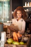 Making sure everything in her cafe is only the best - stock photo