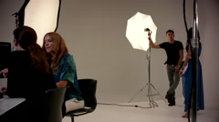Female photographer discussing with fashion model at studio. - stock footage