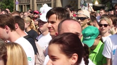 A crowd of people moves on the city. Side view of person Stock Footage