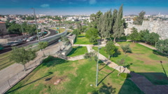 View from the wall to Jerusalem Old Town timelapse with Modern tram and traffic Stock Footage