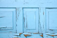 Old woodan wall, shabby paint as background Stock Photos