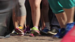 A mass sprint athletes. Feet in sneakers on the pavement, the view from the fron Stock Footage