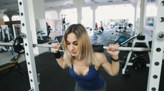 Sexy girl with sexy body doing barbell workout routine in gym, healthy lifestyle Stock Footage