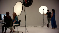 Female photographer discussing with fashion model at studio. Stock Footage