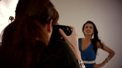 Female photographer photographing fashion model at studio. Stock Footage