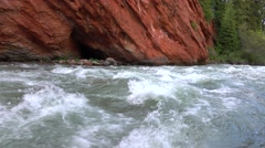 Striped red rock and mountain river rapids 4K video Stock Footage