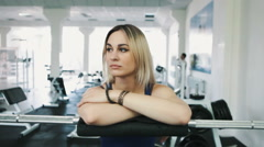 Portrait of sexy blonde girl in gym - stock footage