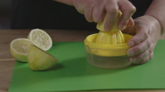 Juicing a lemon Stock Footage