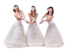 Three carnival dancer women wearing a mask dancing, isolated on white - stock photo