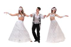 Three carnival dancers wearing a mask dancing, isolated on white Kuvituskuvat