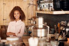 There is always a welcome smile in this cafe - stock photo