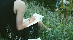 Closeup of Female Artist Drawing in Nature Stock Footage