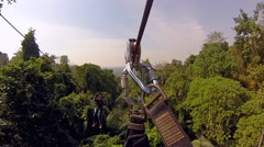 Flying bungee jumping in the jungle of Thailand. Cable car on the trees with a - stock footage