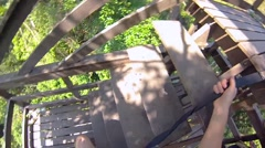 Climbing the stairs to the tree in the jungle of Thailand. Stock Footage