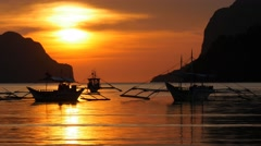 Traditional filippino boats at El Nido bay in sunset lights.  Philippines Stock Footage