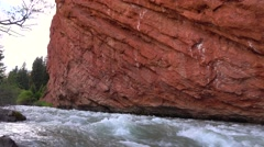 Striped red rock and mountain river rapids 4K video - stock footage